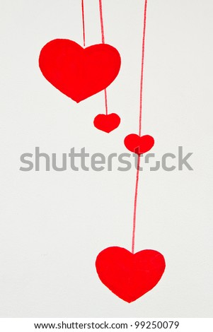red heart painting on wall