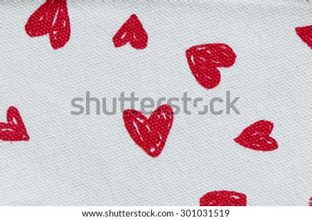 Red heart prints on canvas background / Abstract background / Promotions on children curriculum and activities