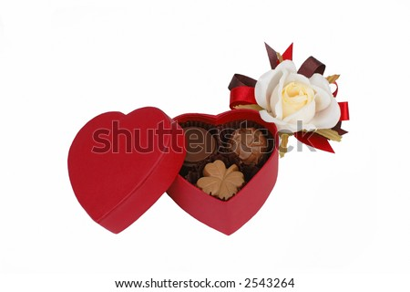 Red heart shape chocolate box and white rose isolated over white background