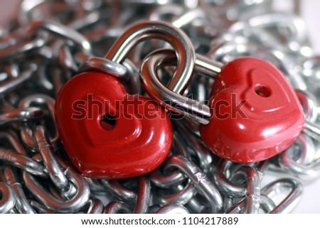 Red heart shape lock and chain. Romantic padlock. #1104217889