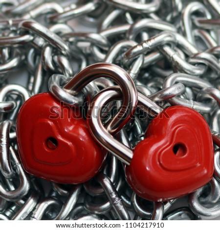 Red heart shape lock and chain. Romantic padlock. #1104217910