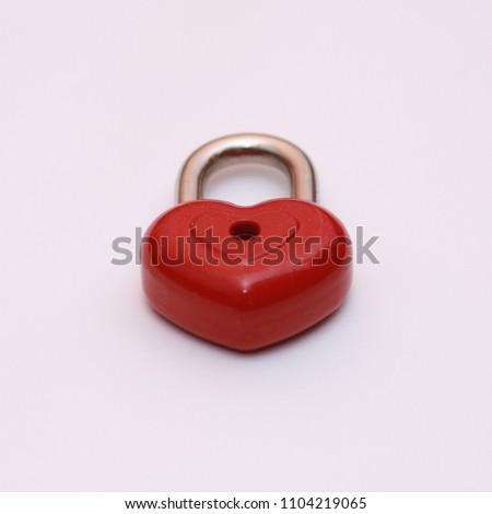 Red heart shape lock. Romantic padlock isolated. #1104219065