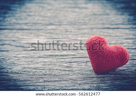red heart shape on wooden table background ,vintage color tone,Image for Happy valentine day concept. #562612477
