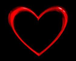 red heart shape over black background