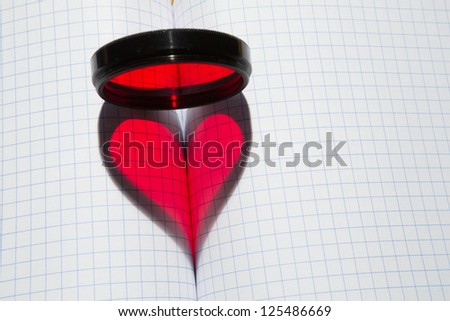red heart shape & photo-filter on blank writing-book in a section