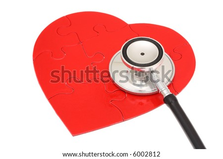 Red heart shape puzzle with stethoscope