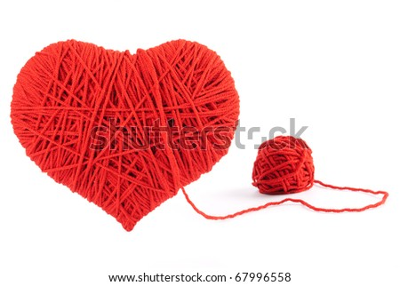 Red heart shape symbol made from wool isolated on white background. Valentine