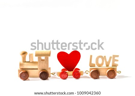 Red Heart Shape with Wooden Toy Train on isolated on white background,Image to Valentine Day concept. #1009042360