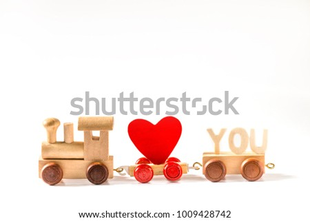 Red Heart Shape with Wooden Toy Train on isolated on white background,Image to Valentine Day concept. #1009428742