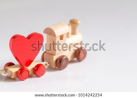 Red Heart Shape with Wooden Toy Train on isolated on white background,Image to Valentine Day concept. #1014242254