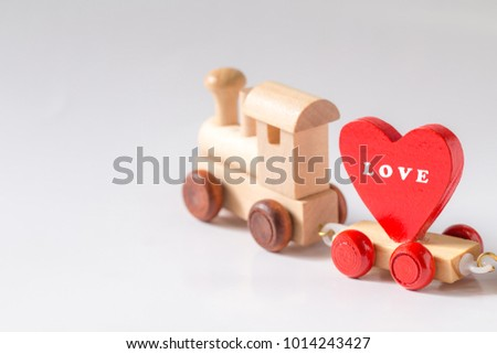 Red Heart Shape with Wooden Toy Train on isolated on white background,Image to Valentine Day concept. #1014243427