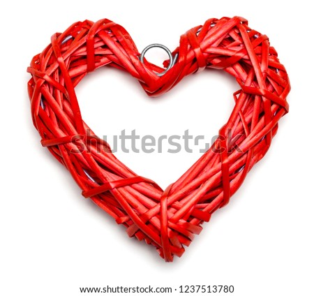 Red heart shaped braided wicker on white background #1237513780