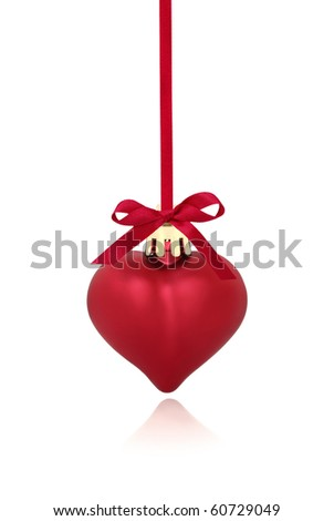 Red heart shaped christmas bauble with ribbon and bow, isolated over white background with reflection.