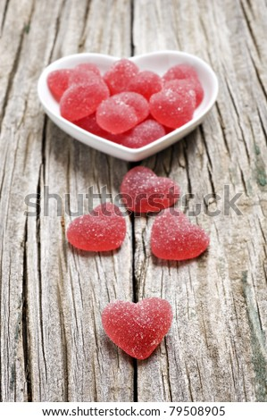 Red heart shaped jelly sweets on a rustic background