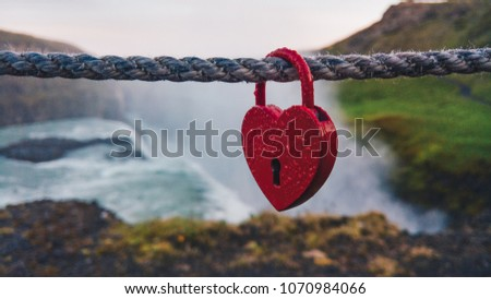 Red heart shaped lock #1070984066