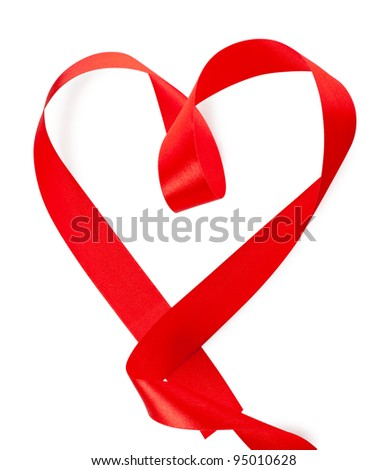 Red heart-shaped silk ribbon over white background