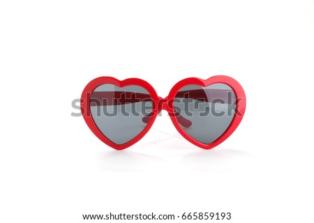 Red heart-shaped sunglasses isolated on white