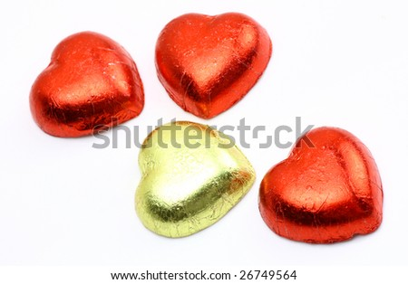 red heart shaped wrapped chocolates