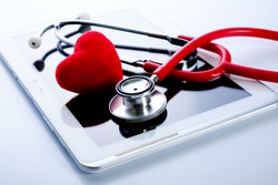 Red heart, stethoscope on tablet pc, health medical technology concepts