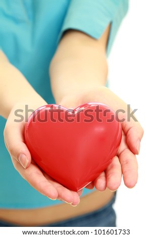 Red heart symbol in female hands isolated - stock photo