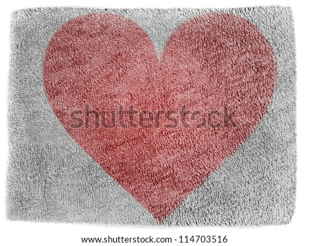 Red Heart symbol painted on grey towel