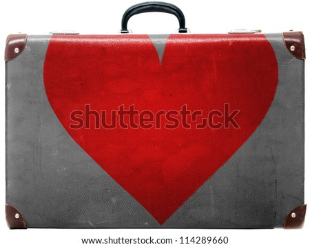 Red Heart symbol painted on old grungy travel suitcase or trunk