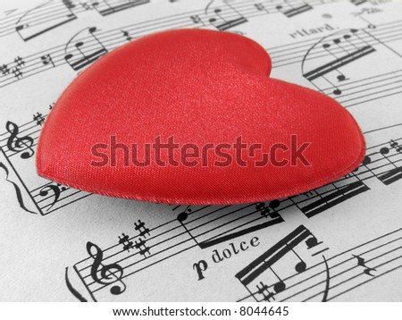 red heart valentine trinket on notes sheet background