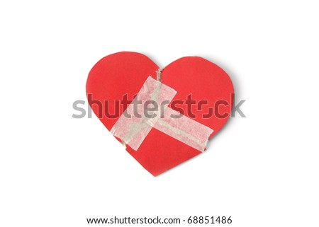 Red heart with adhesive plaster