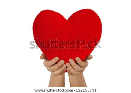 Red heart with hands made from wool isolated on white background