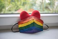 Red heart with lgbt rainbow mask. Pride 2020 during coronavirus quarantine