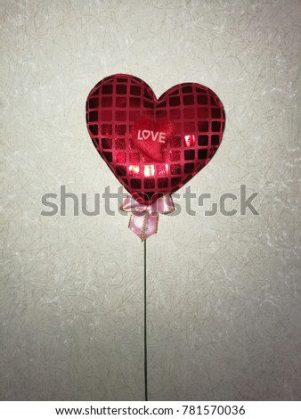 Red heart with LOVE word, attach with green branch and pink ribbon, on random messy line background #781570036
