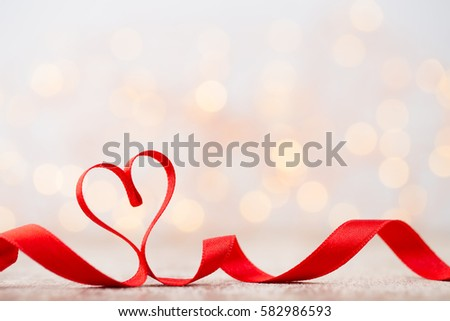Red heart with ribbon. Valentines day background.