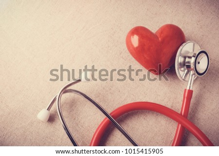 red heart with stethoscope, heart health,  health insurance concept, world health day