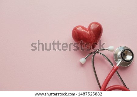 Red heart with stethoscope on pink background, heart health,  health insurance concept, World heart day, world health day, doctor day, world hypertension day