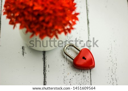 Red hearts and flowers on a white wood floor with space, ideas love or the day of love Valentines Day. #1451609564