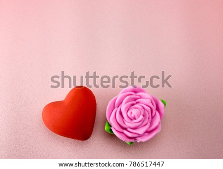 Red hearts and pink rose on a pink plastic background style soft for Valentine's day. #786517447