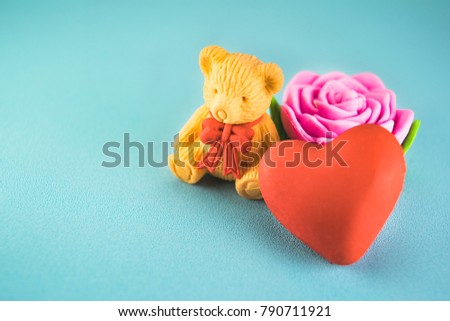 Red hearts,bear and pink rose on a blue plastic background style soft for Valentine's day. Selective focus. #790711921