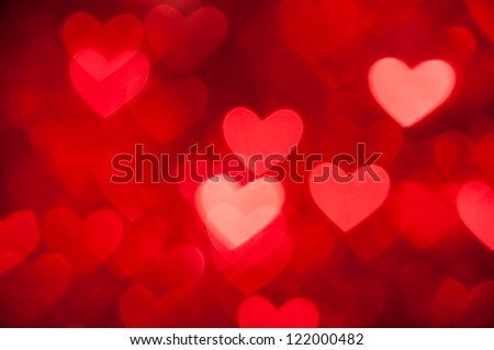 Stock Photo red hearts bokeh as background