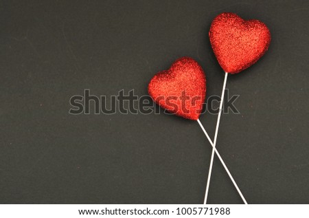 Red hearts on a black background  #1005771988