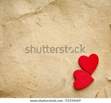 red hearts on vintage  paper background with copyspace