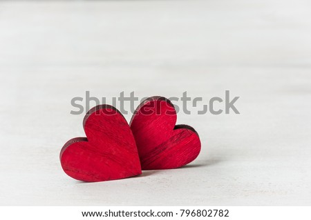 Red hearts on white wooden background. Greeting card. Valentines day concept. Soft focus.