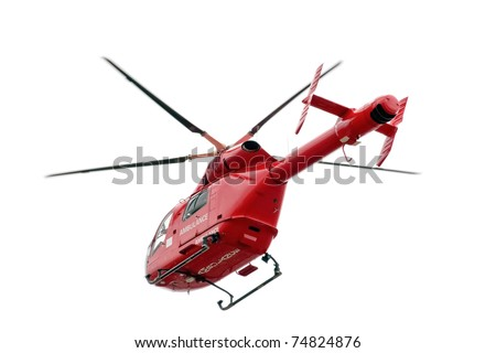 Red helicopter of air ambulance isolated on white background, London - UK