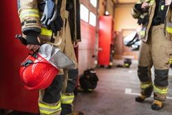 Red helmet in fireman's hand