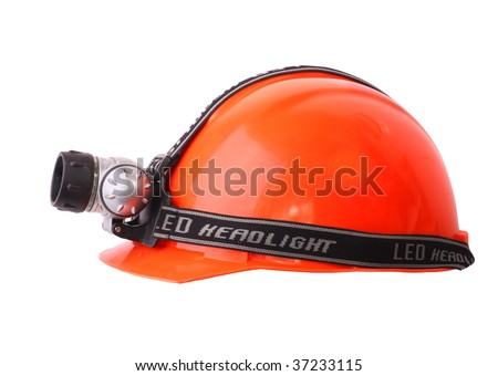 Red Helmet with LED headlight . Isolated object. White background.