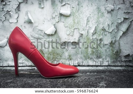 Red high heel shoes on street outdoors with nobody wearing them #596876624