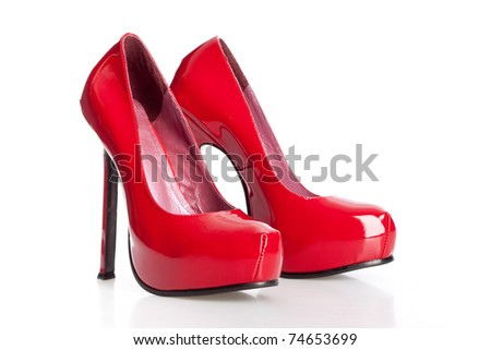 red high heel shoes on the white