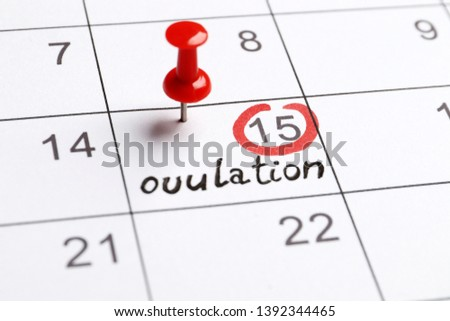 red highlighter with ovulation day mark on calendar, Concept of fertility chart, trying to have baby and natural contraception, Reminder Ovulation in graph with pen, Planning of pregnancy