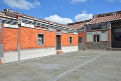 Red historical monument building with nostalgic brick walls