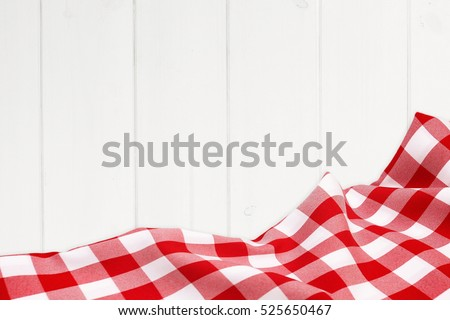 Red holiday tablecloth on the wooden white boards #525650467