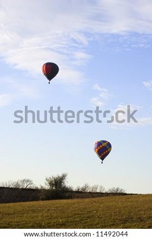 Red hot air balloon over farm fields near Omaha Nebraska
